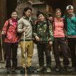 Los cuatro escaladores junto al guía local Jiujiuxiang. Parque Natural Zhangjiajie  (Franz Walter)