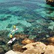 practicando el padel surf en las aguas claras de Punta Rasa